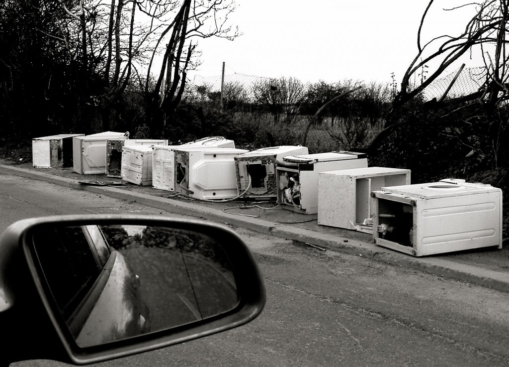 HOUSEHOLD APPLIANCES DUMPED at the side of the road.
